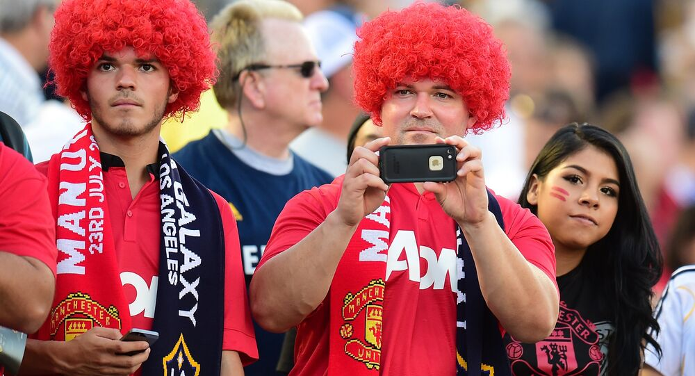 Manchester United fans sporting red-versions of Marouane Fellaini look-a-like wigs await the arrival of players during their Chevrolet Cup match against the LA Galaxy at the Rose Bowl in Pasadena, California on July 23, 2014