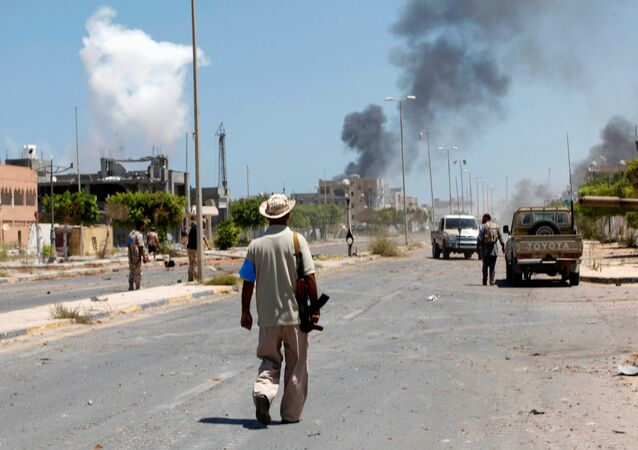 Smoke rises during a battle between Libyan forces allied with the U.N.-backed government and Islamic State fighters in neighborhood Number Two in Sirte, Libya August 16, 2016
