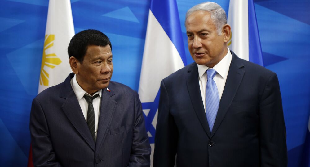 Israeli Prime Minister Benjamin Netanyahu, right, stands next to Philippine President Rodrigo Duterte during their meeting in Jerusalem on Monday, Sept. 3, 2018