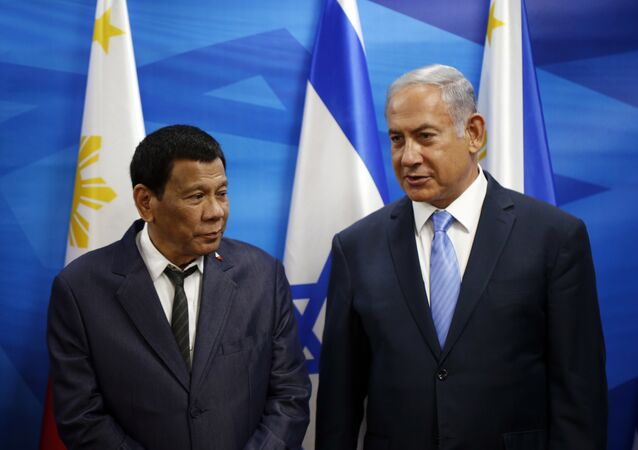 Israeli Prime Minister Benjamin Netanyahu, right, stands next to Philippine President Rodrigo Duterte during their meeting in Jerusalem on Monday, Sept. 3, 2018