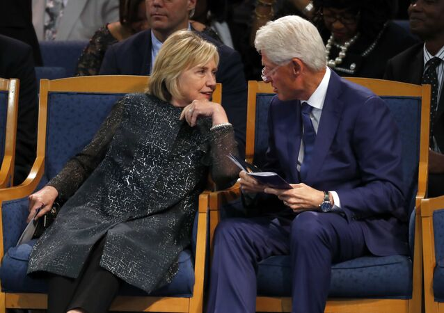 Former President Bill Clinton and wife Hillary Clinton, left, talking during the funeral service for Aretha Franklin at Greater Grace Temple, Friday, Aug. 31, 2018, in Detroit