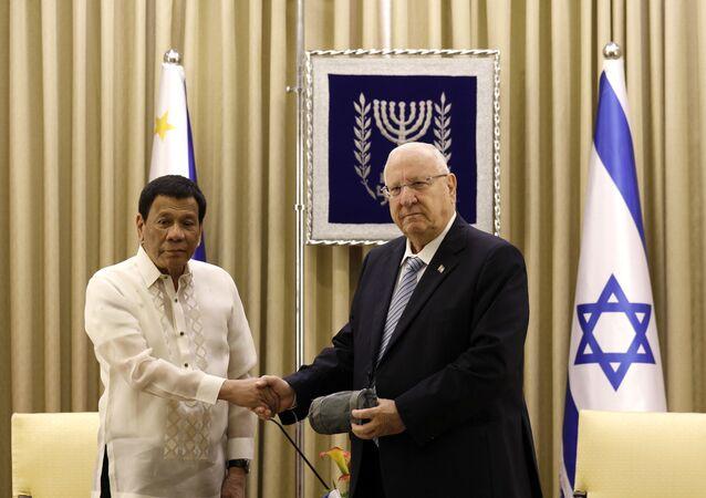 Israeli President Reuven Rivlin, right, shakes hands with his Philippine counterpart Rodrigo Duterte, in Jerusalem, Israel, Tuesday, Sept. 4, 2018
