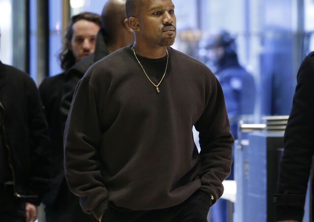 Kanye West enters Trump Tower in New York, Tuesday, Dec. 13, 2016