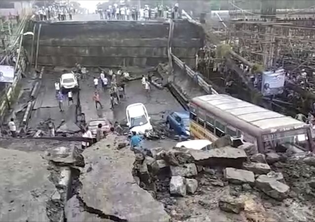 This grab made from video provided by Indranil Mukherjee, an eyewitness shows a highway overpass that collapsed in Kolkata, India, Tuesday, Sept. 4, 2018.
