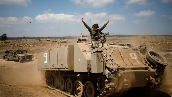 An Israeli soldier rides an armoured vehicle during a army drill after the visit of Israeli Defence Minister Avigdor Lieberman in the Israeli-occupied Golan Heights, Israel August 7, 2018 - Sputnik International