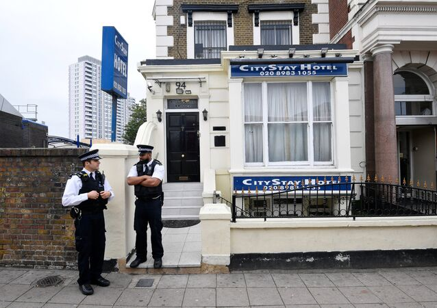 Police officers stand outside the City Stay Hotel used by Alexander Petrov and Ruslan Boshirov; who have been accused of attempting to murder former Russian spy Sergei Skripal and his daughter Yulia; in London, Britain September 5, 2018
