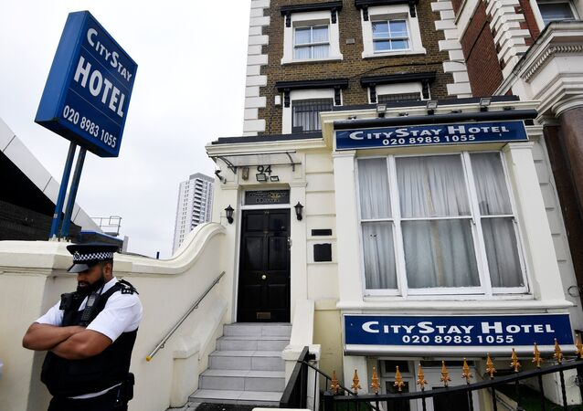 A police officer stands outside the City Stay Hotel used by Alexander Petrov and Ruslan Boshirov; who have been accused of attempting to murder former Russian spy Sergei Skripal and his daughter Yulia; in London, Britain September 5, 2018