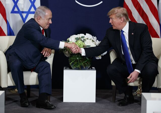 "This Jan. 25, 2018 file photo shows President Donald Trump meeting with Israeli Prime Minister Benjamin Netanyahu at the World Economic Forum in Davos. There's much to celebrate but plenty of cause for trepidation, too, as Trump and Netanyahu meet Monday, March 5, 2018 at the White House. For all his talk about brokering the ""ultimate deal"" between Israelis and Palestinians, Trump's long-awaited peace plan has yet to arrive, even as Palestinians and other critics insist it will be dead on arrival"