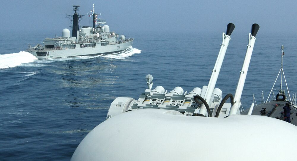 British Royal Navy Guided missile Destroyer HMS Exeter (L) passes a Chinese naval vessel, off the eastern port city of Qingdao. File photo
