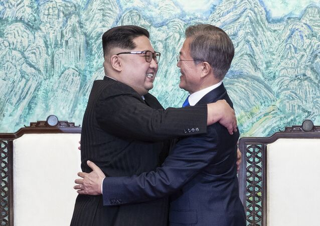 North Korean leader Kim Jong Un, left, and South Korean President Moon Jae-in embrace each other after signing on a joint statement at the border village of Panmunjom in the Demilitarized Zone, South Korea, Friday, April 27, 2018.