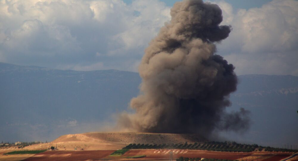 Smoke rises near the Syrian village of Kafr Ain in the southern countryside of Idlib province after an airstrike on September 7, 2018