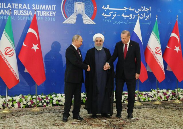 Russian President Vladimir Putin, Iranian President Hassan Rouhani, and Turkish President Recep Tayyip Erdogan during trilateral talks in Tehran.