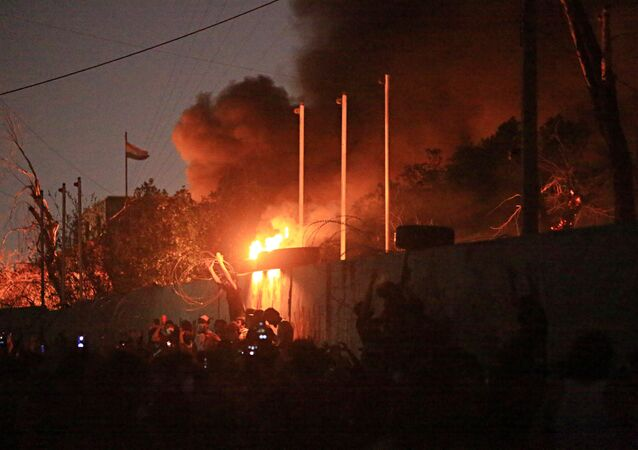 People burn the governor's building during protests demanding better public services and jobs in Basra, 340 miles (550 km) southeast of Baghdad, Iraq