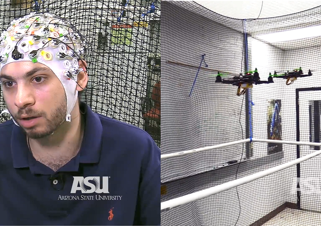Researchers in the Human-Oriented Robotics and Control Lab at the University of Arizona demonstrate a single user flying three drones using a brain-computer interface