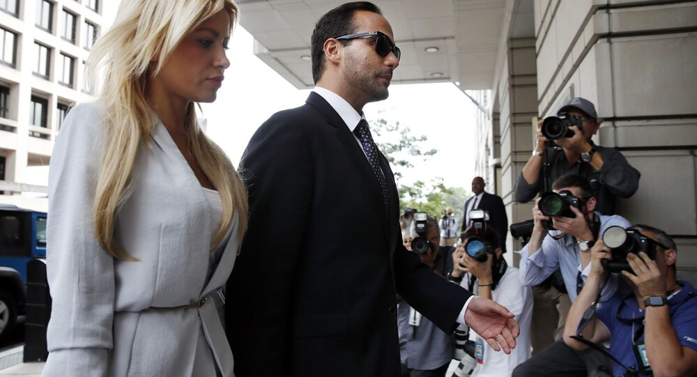 Former Donald Trump presidential campaign adviser George Papadopoulos, who triggered the Russia investigation, and who pleaded guilty to one count of making false statements to the FBI walks with his wife Simona Mangiante, left, as they arrive at federal court for sentencing, Friday, Sept. 7, 2018, in Washington.