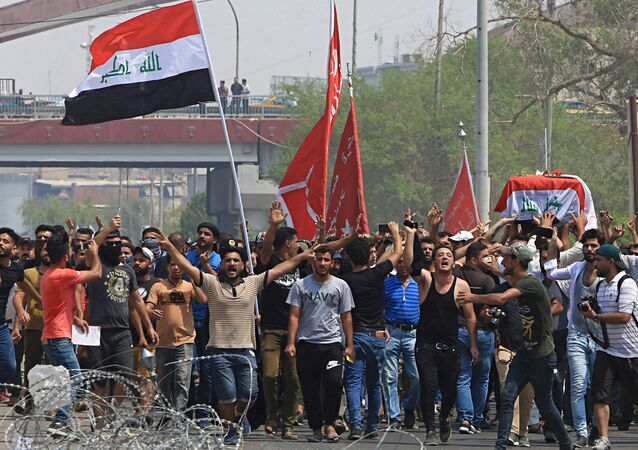 Mourners chant anti government slogans while carrying the Iraqi flag-draped coffin of Mekki Yasser, a protester whose family and activists said he was killed when he participated in a protest last night, during his funeral on Tuesday, Sept. 4, 2018