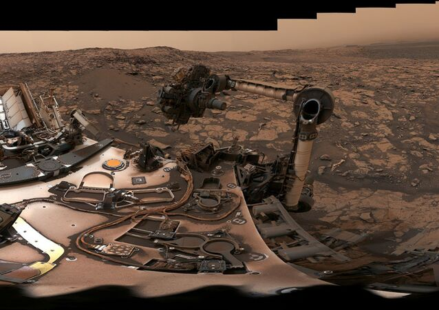After snagging a new rock sample on August 9, 2018 (Sol 2137), NASA's Curiosity rover surveyed its surroundings on Mars, producing a 360-degree panorama of its current location on Vera Rubin Ridge. The scene is presented with a color adjustment that approximates white balancing, to resemble how the rocks and sand would appear under daytime lighting conditions on Earth.