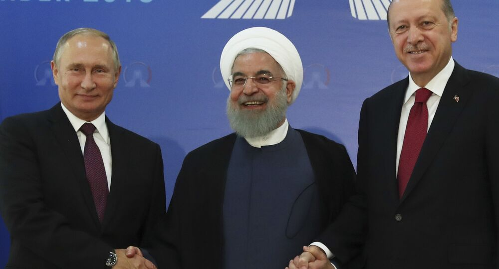 Iran's President Hassan Rouhani, centre, flanked by Russia's President Vladimir Putin, left, and Turkey's President Recep Tayyip Erdogan, pose for photographs in Tehran, Iran, ahead of their summit to discuss Syria, Friday, Sept. 7, 2018