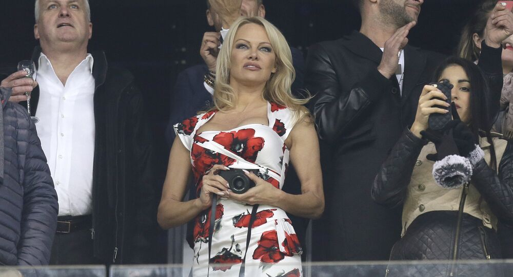 US actress Pamela Anderson awaits the start of the League One soccer match between Marseille and Monaco, at the Velodrome Stadium, in Marseille, southern France, Sunday, Jan. 28, 2018.