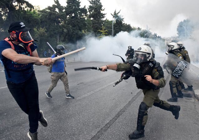 Protesters clash with police during a demonstration in Thessaloniki