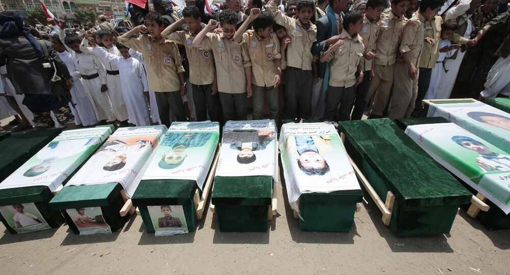 In this Aug. 13, 2018, file photo, Yemeni people attend the funeral of victims of a Saudi-led airstrike, in Saada, Yemen