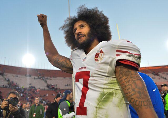 San Francisco 49ers quarterback Colin Kaepernick pumps his fist as he acknowledges the cheers at Los Angeles Memorial Coliseum in Los Angeles, California, U.S. on December 24, 2016