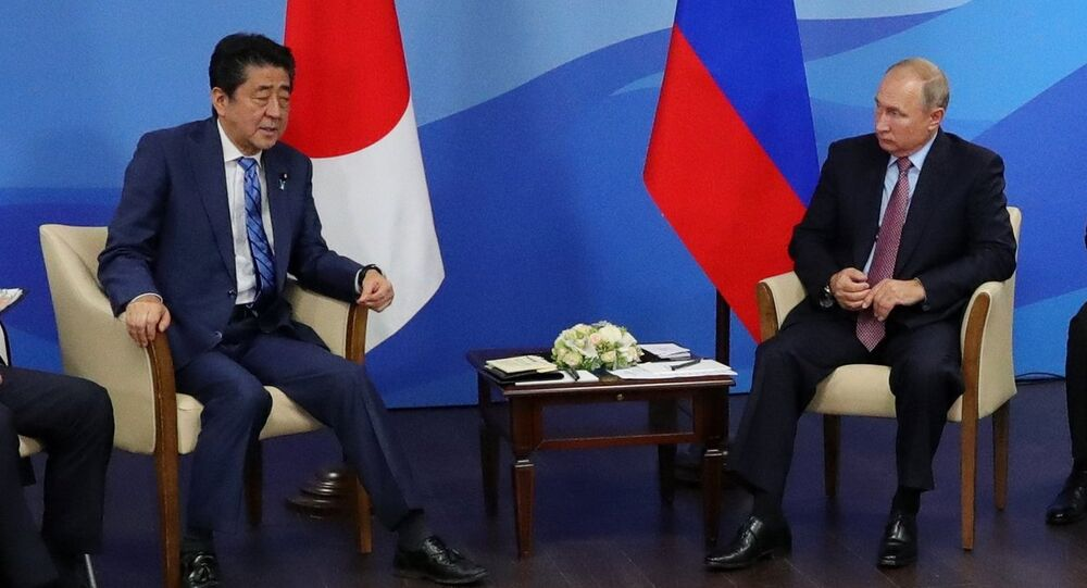 September 10, 2018. Russian President Vladimir Putin and Japanese Prime Minister Shinzō Abe, center left, during a meeting in Vladivostok