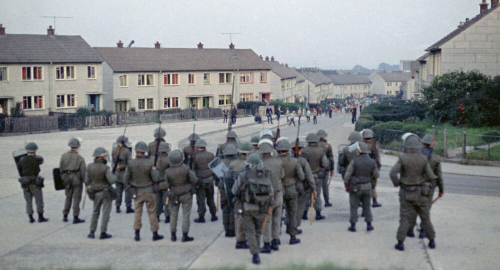British troops confront young rioters on the Ballymurphy Estate in Belfast, Northern Ireland in 1970.