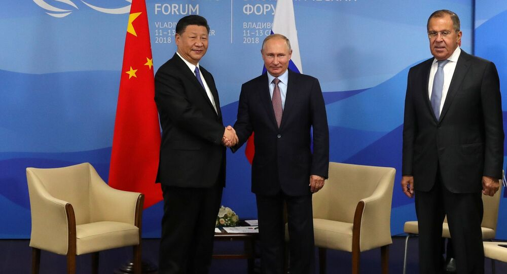 September 11, 2018. President Vladimir Putin and Chinese President Xi Jinping, left, during a meeting on the sidelines of the 4th Eastern Economic Forum at the Far Eastern Federal University on the Russky Island. Right: Foreign Minister Sergei Lavrov