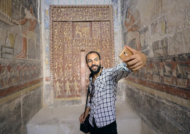 A man takes a selfie in a chamber of the tomb of Mehu, after it was opened for the public at Saqqara area near Egypt's Saqqara necropolis, in Giza, Egypt September 8, 2018.