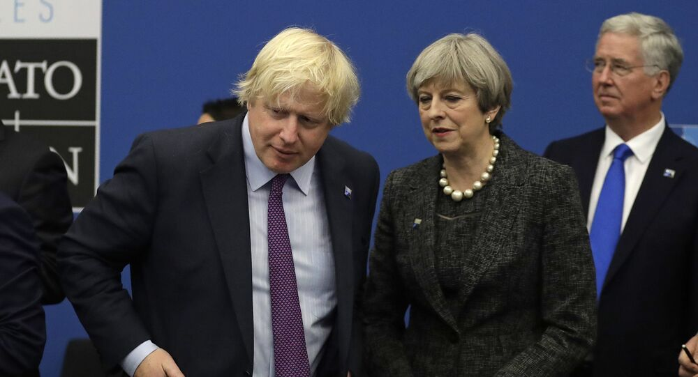 British Prime Minister Theresa May and British Foreign Minister Boris Johnson look toward Turkish President Recep Tayyip Erdogan, right, as they participate in a working dinner meeting at the NATO headquarters during a NATO summit of heads of state and government in Brussels on Thursday, May 25, 2017