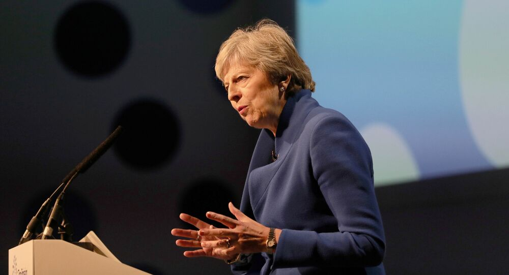 Britain's Prime Minister Theresa May makes a speech at the Zero Emission Vehicle Summit at the ICC in Birmingham September 11, 2018
