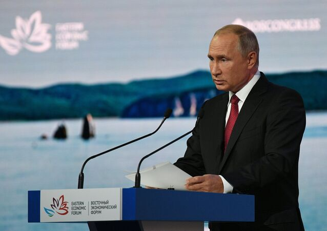 Vladimir Putin is seen giving a speech at a plenary session during the 2018 Eastern Economic Forum on September 12
