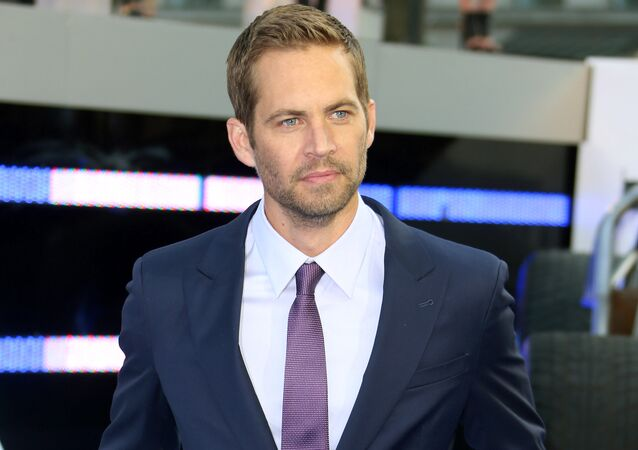 """In this May 7, 2013 file photo, actor Paul Walker arrives for the World Premiere of Fast & Furious 6, in central London. Wiz Khalifa and Charlie Puth's song, """"See You Again,"""" a tribute to Walker, hit No.1 on Billboard Hot 100's chart this week. It is featured on the """"Furious 7"""" soundtrack, which debuted at No.1 on Billboard's 200 albums chart this week"""