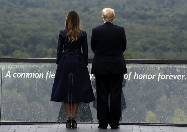 President Donald Trump and first lady Melania Trump, stand along the September 11th Flight 93 Memorial, Tuesday, Sept. 11, 2018, in Shanksville, Pa.