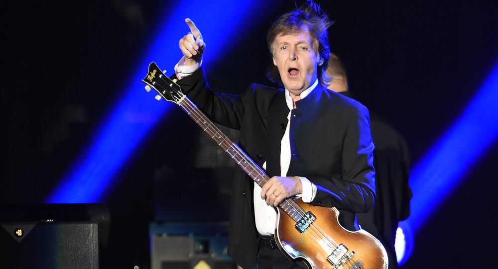 Paul McCartney greets the crowd as he arrives onstage for his performance on day 2 of the 2016 Desert Trip music festival at Empire Polo Field on Saturday, Oct. 8, 2016, in Indio, Calif