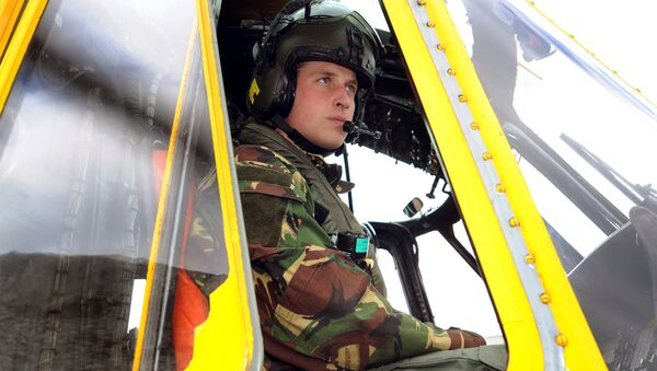 Britain's Prince William is pictured at the controls of a Sea King helicopter during a training exercise at Holyhead Mountain, having flown from RAF Valley in Anglesey, north Wales, on March 31, 2011. - Sputnik International