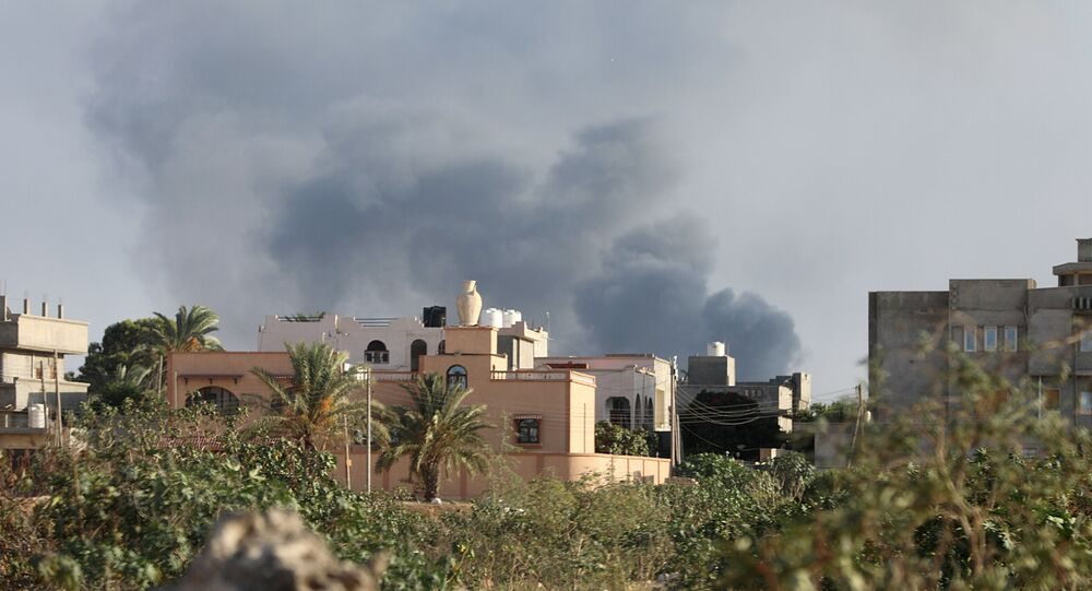 Smoke rises during heavy clashes between rival factions in Tripoli, Libya, August 28, 2018.