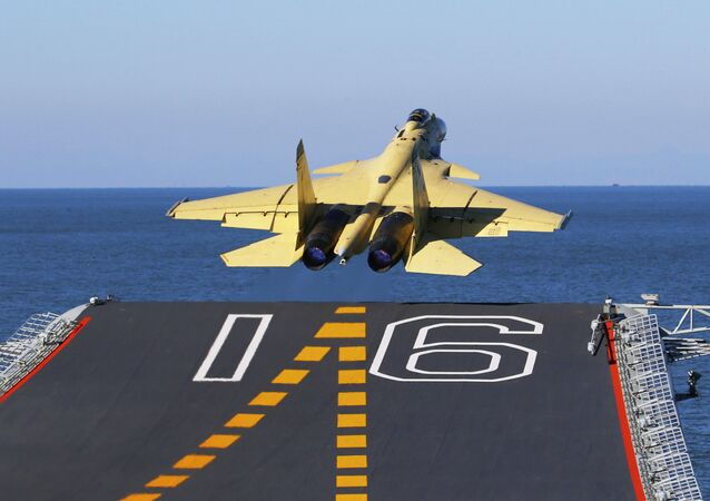 In this undated photo released by China's Xinhua News Agency, made available on Sunday, Nov. 25, 2012, a carrier-borne J-15 fighter jet takes off from China's first aircraft carrier, the Liaoning. China has successfully landed a fighter jet on its first aircraft carrier, which entered service two months ago, the country's official news agency confirmed Sunday. The Liaoning aircraft carrier underscores China's ambitions to be a leading Asian naval power, but it is not expected to carry a full complement of planes or be ready for combat for some time.