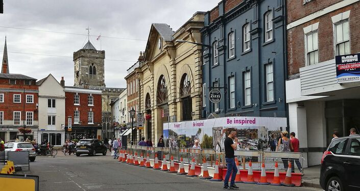 In this photo taken on Friday, July 20, 2018, a security cordon encouraging people to return to Salisbury amid the crisis and ensuing recovery scheme, surrounds 'Zizzi's restaurant on Castle Street in Salisbury