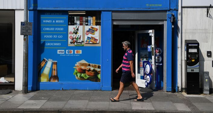 A pedestrian walks past a newsagent shop, one of the last places visited by 44-year old Dawn Sturgess before she fell ill on June 30, in Salisbury