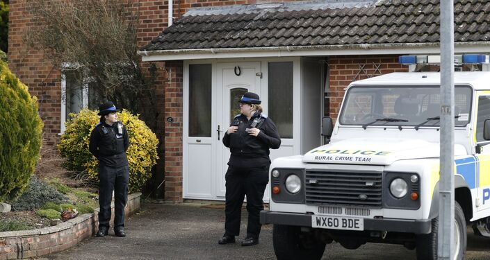 Police officers stand outside Sergei Skripal's residence in Salisbury