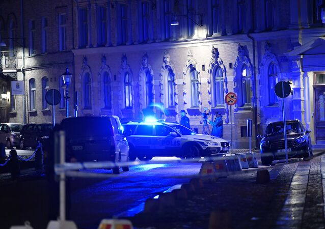 Police arrive after a synagogue was attacked in a failed arson attempt in Gothenburg, Sweden, late December 9, 2017