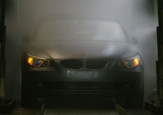 A 5 Series BMW car is washed during assembling at Avtotor factory in Kaliningrad, 30 March 2004.