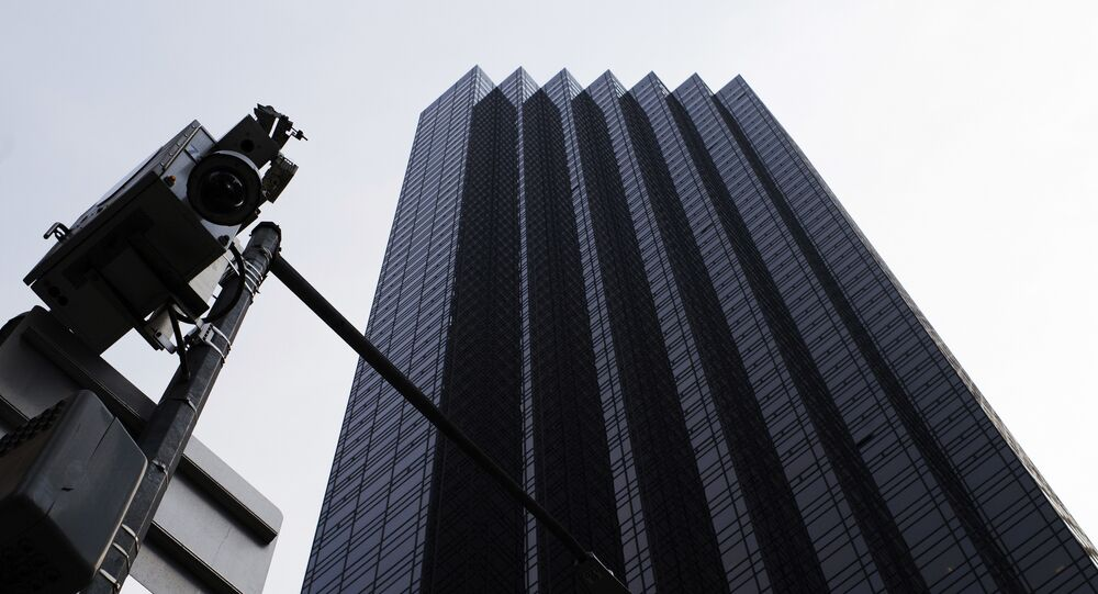 A New York Police Department surveillance camera, left, is mounted on a light pole outside Trump Tower, Monday, Aug. 27, 2018, in New York