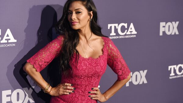 Nicole Scherzinger, a cast member in the reality television series The Masked Singer, turns back for photographers at the FOX Summer TCA All-Star Party at Soho House West Hollywood, Thursday, Aug. 2, 2018, in West Hollywood, Calif (Photo by Chris Pizzello/Invision/AP) - Sputnik International