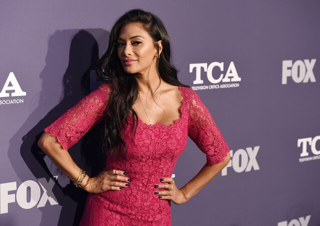 Nicole Scherzinger, a cast member in the reality television series The Masked Singer, turns back for photographers at the FOX Summer TCA All-Star Party at Soho House West Hollywood, Thursday, Aug. 2, 2018, in West Hollywood, Calif (Photo by Chris Pizzello/Invision/AP)