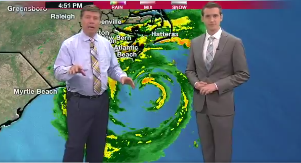 Meteorologists in North Carolina station during Florence hurricane.