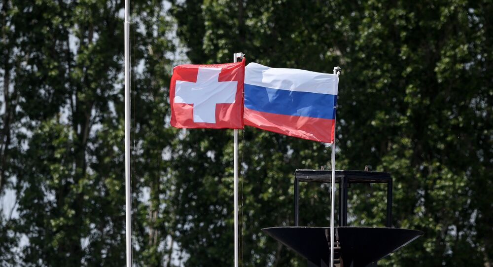 The Swiss and Russian flags (File)