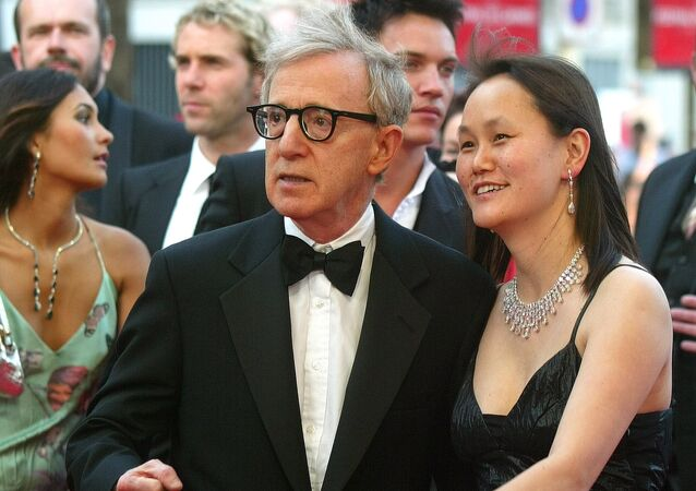American director Woody Allen and his wife Soon-Yi Previn arrive for the screening of Match Point directed by Woody Allen, at the 58th international Cannes film festival, southern France, Thursday, May 12, 2005